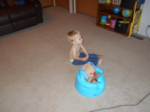Truett takes good care of his goggy. He sits him in the bumbo and watches cartoons with him. :) LOVE!!!