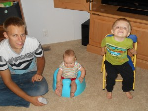 This was Truett's idea. Levi was sitting in his Bumbo and Tru brought his chair over so Levi wouldn't be alone.
