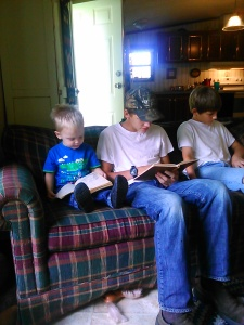 He reads books with his uncles. Whatever they do, he does. :)